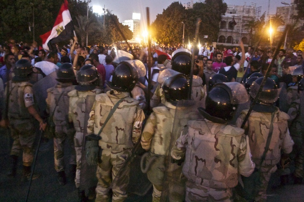 Soldiers prevent civilians from approaching clashes in central Cairo.