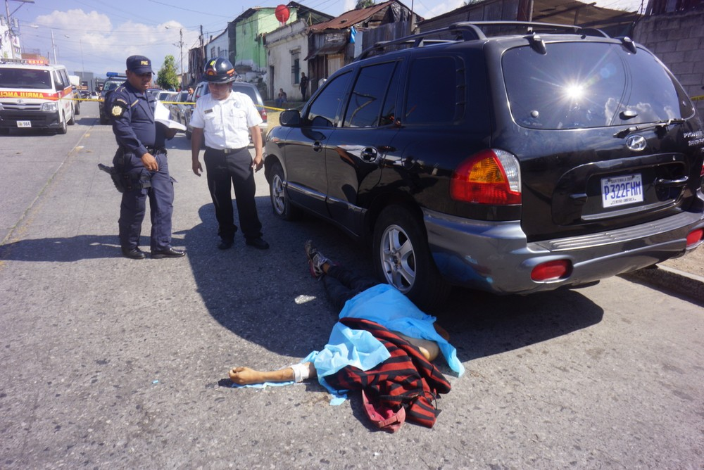 A body lies on the pavement in Guatemala City.