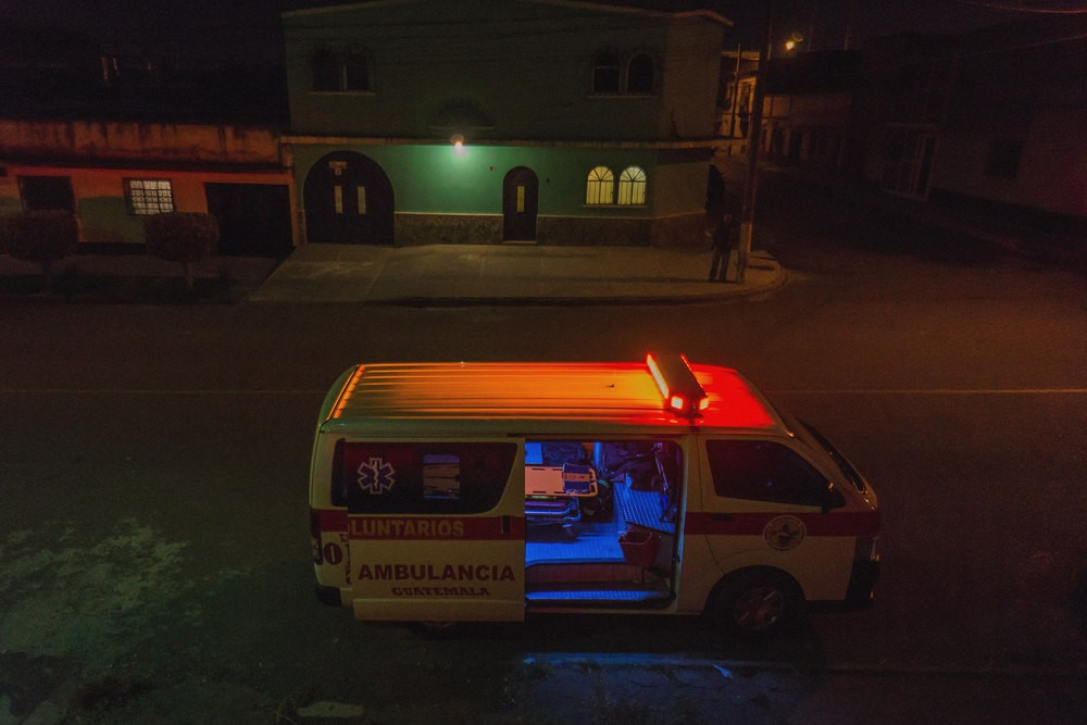 A volunteer medic ambulance parked on the street.
