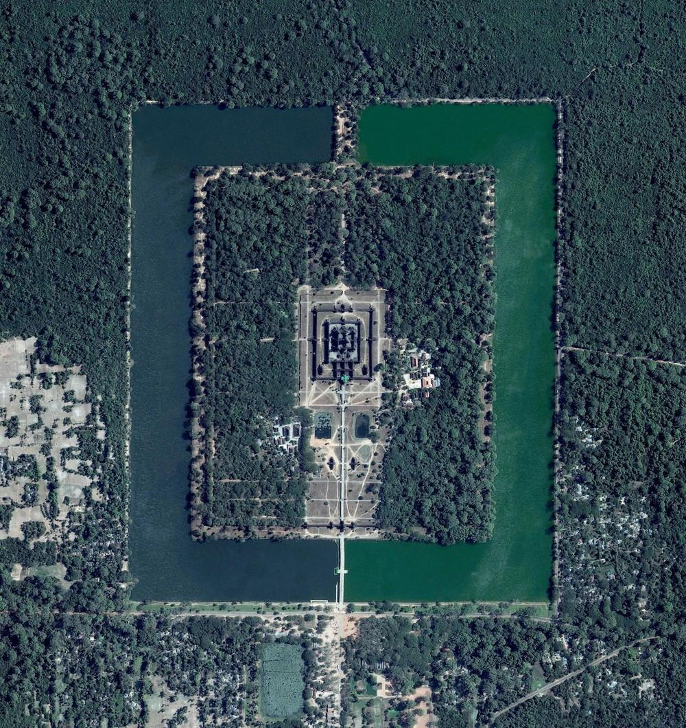 Angkor Wat, a temple complex in Cambodia, is the largest religious monument in the world (first it was Hindu, then Buddhist). Constructed in the twelfth century, the 820,000 square metre (8.8 million square foot) site features a moat and forest that surround a massive temple at its centre.