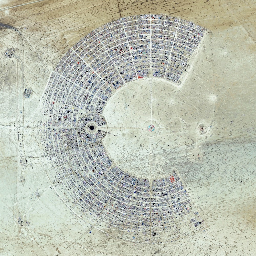 Burning Man is a week-long, annual event held in the Black Rock Desert of Nevada, USA. Drawing more than 65,000 participants each year, the event is described as an experiment in community, art, self-expression, and radical self-reliance. This image was taken during the event, in August 2014 …