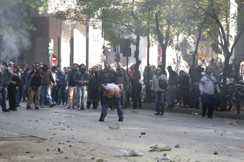 "Henry Langston,  <a href=""http://www.vice.com/en_uk/read/athens-greece-riots-protests-anarchy-syntagma-square"" target=""blank"">We Spent Yesterday Crying in the Athens Riots</a>"