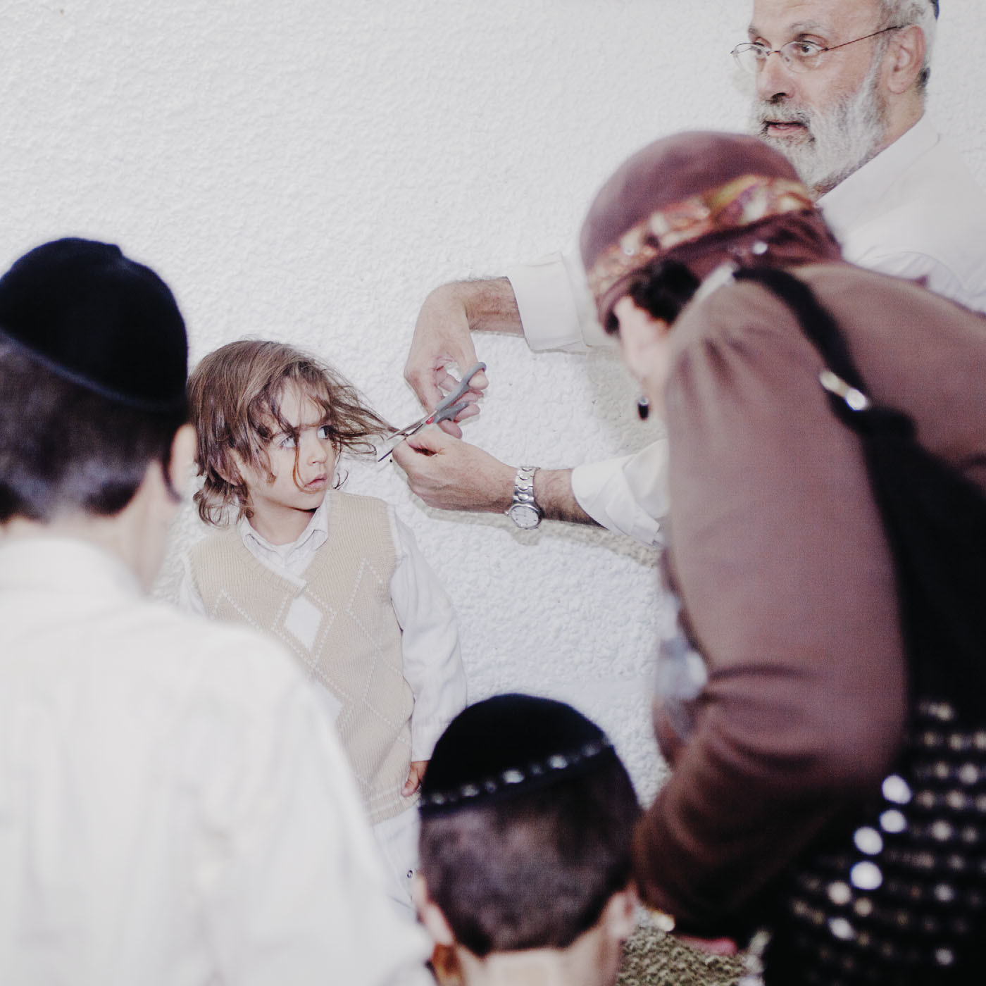 A Jewish boy gets his first haircut at the age of three, as mandated by the Torah, 2009.
