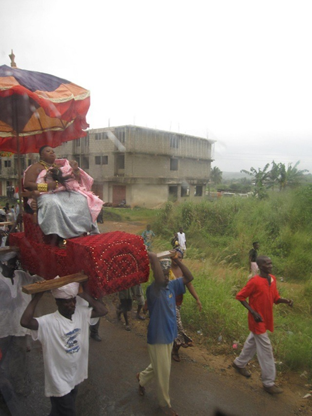 Chiefs and their families being carried during a festival near the city of Nkaw Kaw.