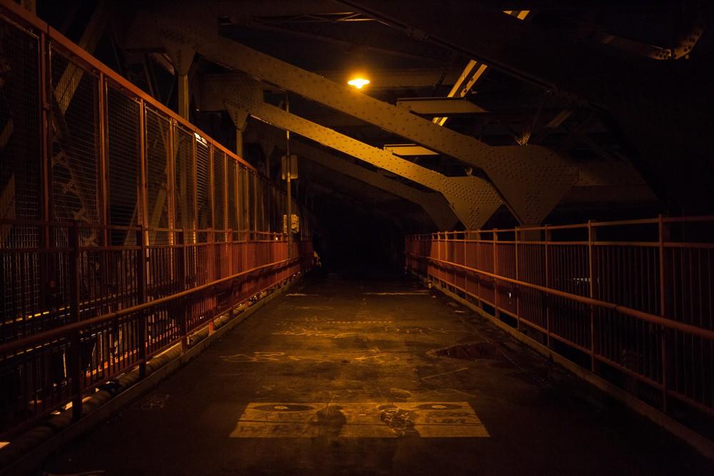 Crossing the half-lit Williamsburg Bridge into a pitch-black Manhattan.