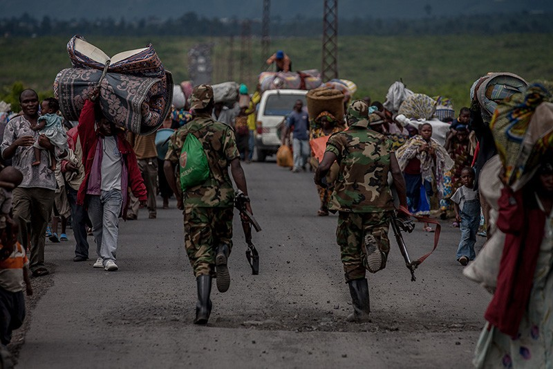 M23 soldiers race toward Sake, to fight Mai Mai comabatants, supported by FARDC troops.