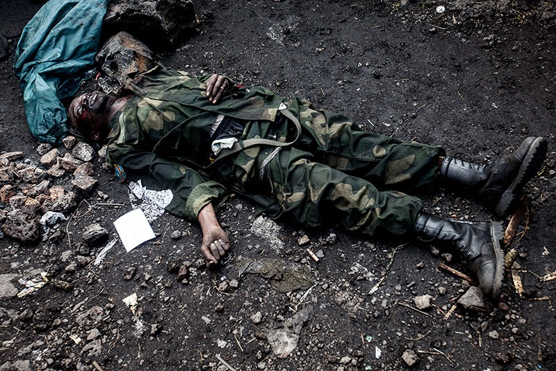 The corpse of a slain FARDC soldier lies at the side of the road on November 21, 2012.