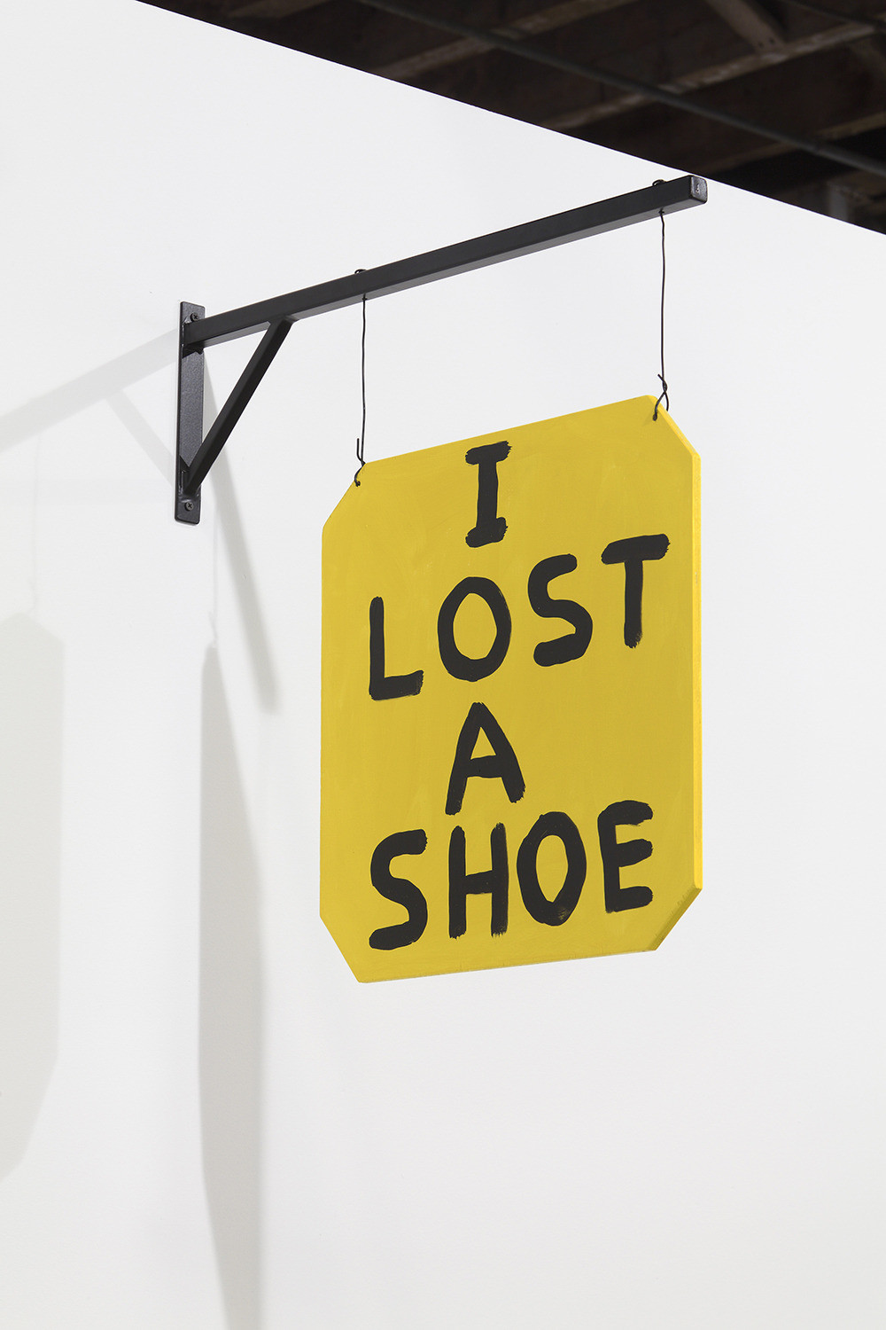 David Shrigley, I Found a Shoe, 2012, Acrylic on plywood with steel armature, 16 1/2 x 16 1/2 x 1/4 inches (sign), Courtesy Anton Kern Gallery, New York