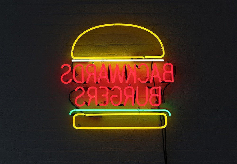David Shrigley, Backwards Burgers, 2013, Neon light, 26 x 27 1/2 x 2 inches, Courtesy Anton Kern Gallery, New York