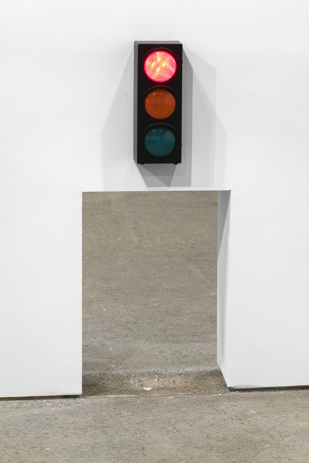 David Shrigley, Hole with Traffic Lights, 2013, Traffic light and hole in drywall, Variable Courtesy Anton Kern Gallery, New York