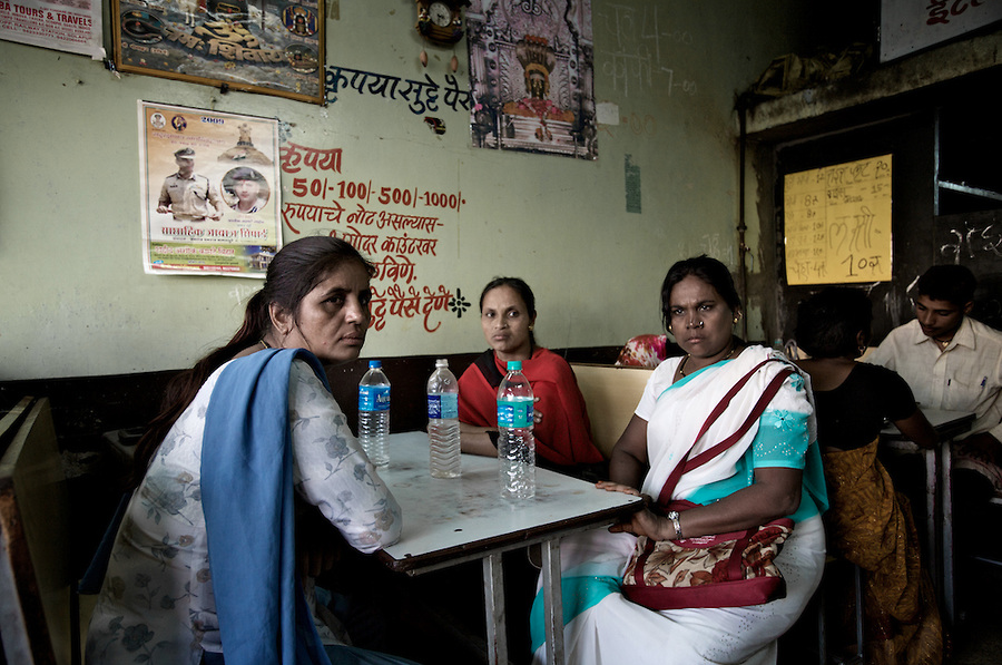 Hajra, Mumtaz, and Sheinaz take a break from fieldwork in a red-light district in Solapur, South Maharashtra. The three women work as peer educators with SAI, an NGO based in Mumbai.