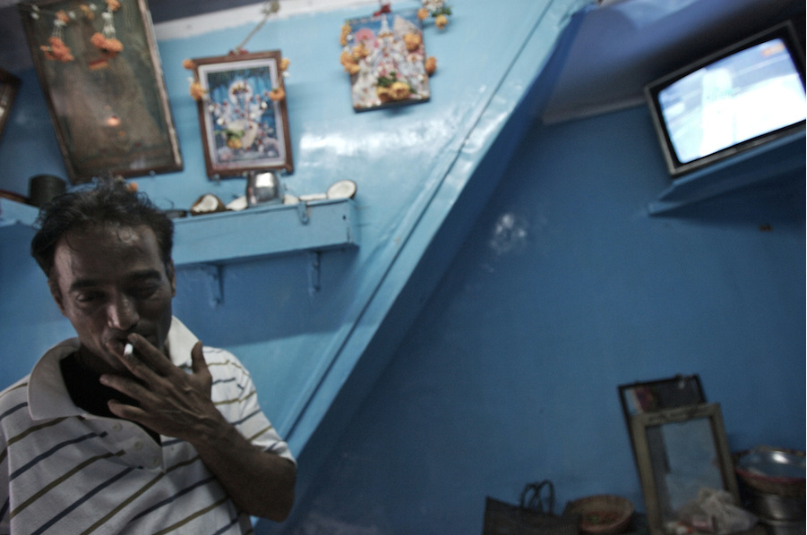 A customer at the brothel in 14th Lane, Kamathipura. Many of the clients have problems with drugs and alcohol, which can make them violent.