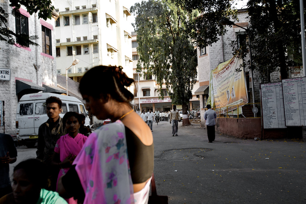 Hajra waits with family and friends outside the trauma care unit of a Mumbai hospital for news of Mumtaz, who was admitted with burns to 85 percent of her body after being set on fire.
