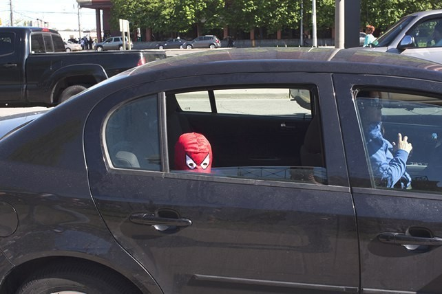 Spiderman waits for his mom to drive him home from Anime North.