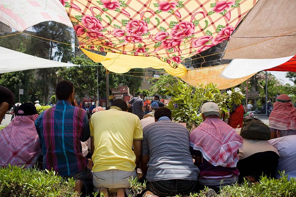 Muslin Brotherhood supporters stop for midday prayers outside Rabaa Al-Adawiya mosque in Nasr City on June 28.