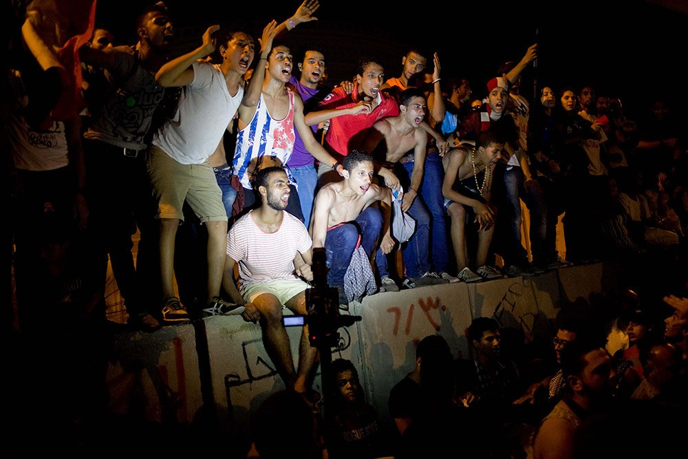 Opposition supporters break out in early celebration, singing and dancing outside the presidential palace on June 30, hoping for Morsi's departure.