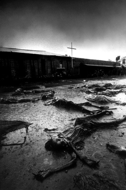 Tutsies slaughtered, lay outside a Belgian built catholic church during the Rwandan genocide.