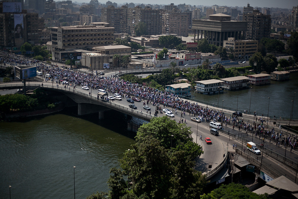 "Hundreds and hundreds of pro-morsi supporters march on 15 May bridge  towards Zamalek a neighbourhood in Cairo on ""day of Anger."" Gun fire could be heard for hours throughout the area."
