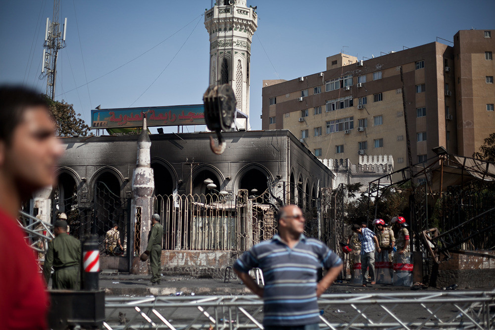 Raba'a al-Adawiya Mosque burned down when security forces cleared the area.  After security forces dispersed the sit in.  Over 600 people have been killed and thousands injured in Egypt.
