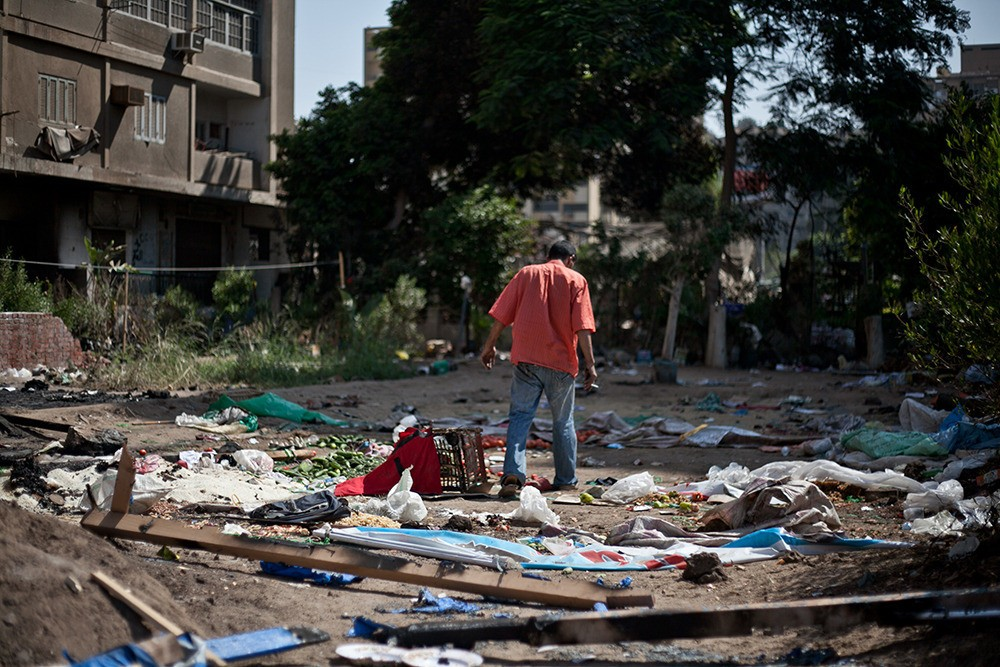 Residents help clean up the aftermath at Raba'a al-Adawiya the day after security forces dispersed the sit in.
