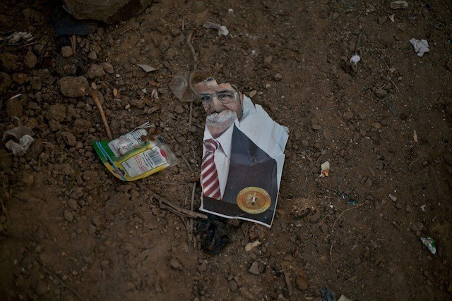 A ripped poster of ex-Egyptian president Mohamed Morsi found on the ground at Raba'a al-Adawiya a day after the sit in was cleared.