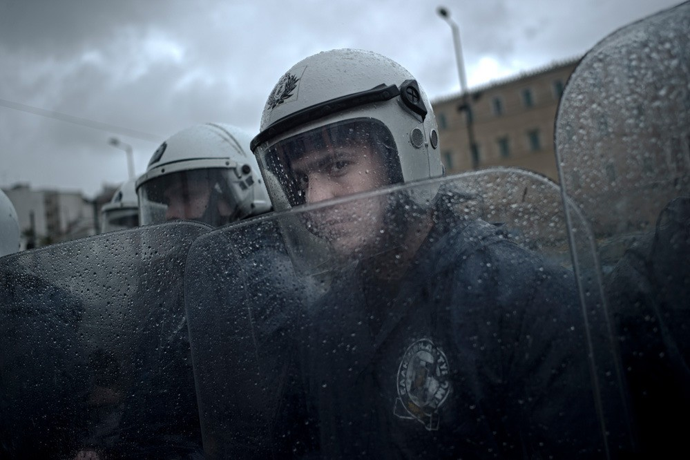 The Greek government deals with the discontented public by empowering the police forces. On the days of large demonstrations, thousands of police officers fill the streets of Athens and the capital turns into a war zone. This is slightly ironic, because police officers' salaries have been reduced greatly in the past years as well.