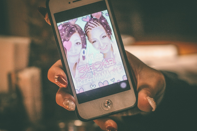 "A former B-styler shows a photo she took with her friend in a ""purikura"" (Japanese photo booth), from when she used to follow B-style. Her nickname was ""Big Mama""."