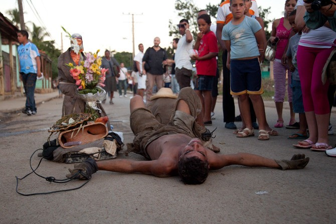 The pilgrimage of San Lazaro is the largest religious event in Cuba. Every December 17, people come from all over the country to pray for good health or to be healed. Many of them go to great lengths to show their dedication, such as this man who dragged a concrete statue on his back for nine miles.