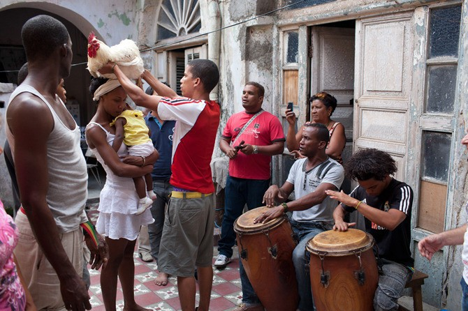 Animal sacrifice is an integral part of the rituals. Before the sacrifice, the animal is passed between those involved to take away their negative energy, which will then be released through the animal's death. Music is also an important part of the practice; the Orishas are raised and brought into the physical realm through drumming and African-style call-and-response chanting.