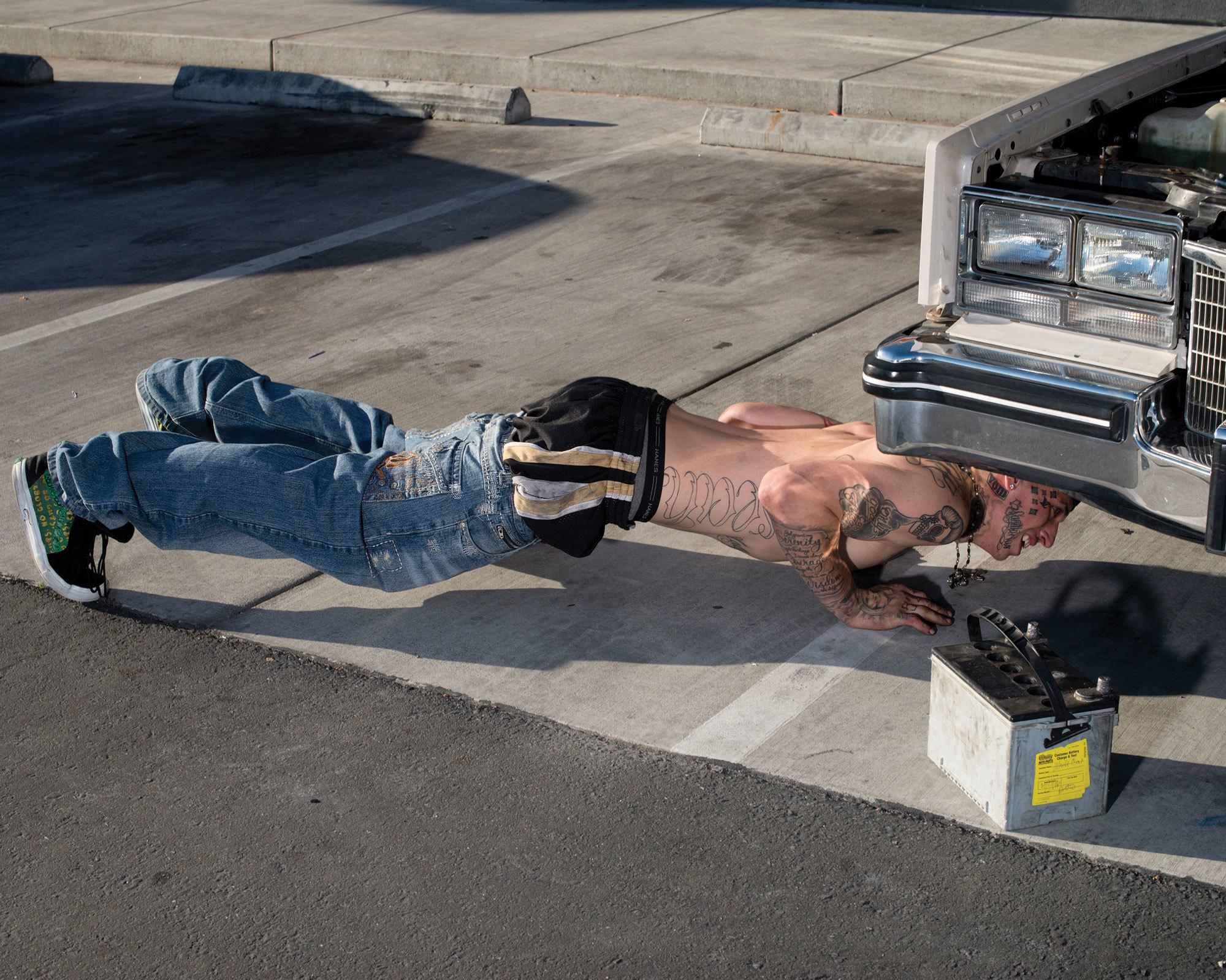 Work On Car Autozone Parking Lot